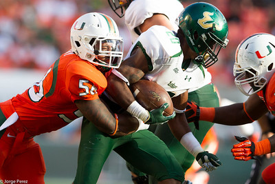 Stephen Morris threw for 413 yards and three scores, Herb Waters had an 87-yard touchdown catch for Miami's longest reception in more than five years and the Hurricanes rolled past South Florida 40-9 on Saturday.