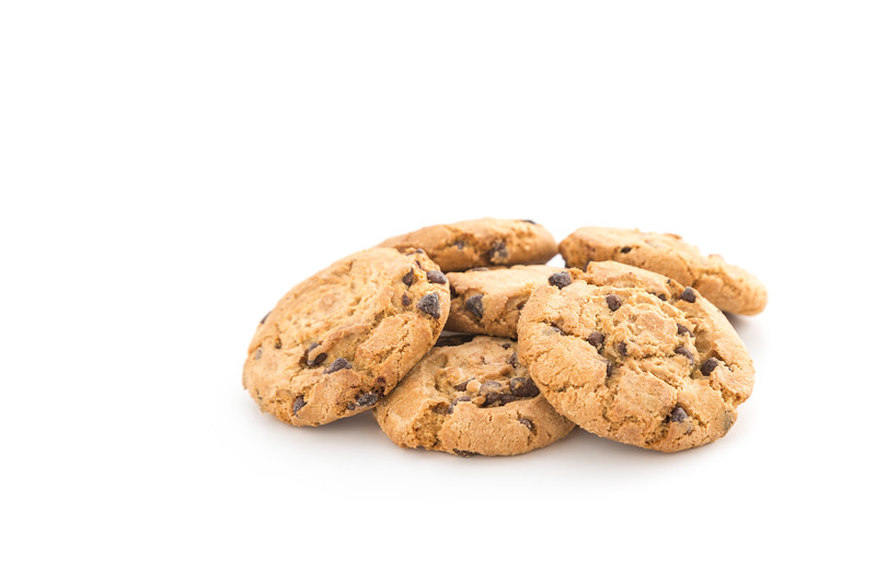 Heap of Chocolate Chip Cookies on White Background
