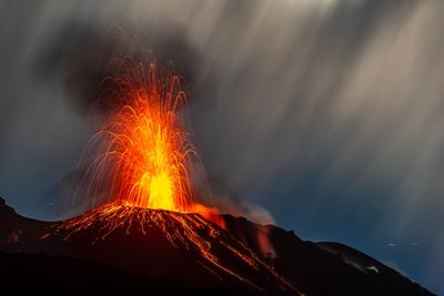 Tall strombolian eruption from the NE vent of Stromboli under moonlight, July 2021