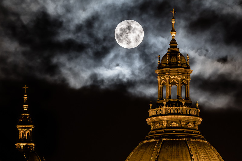 """The November 14, 2016 """"supermoon"""" looms over the dome of Budapest's Szent Istvan Basilica."""