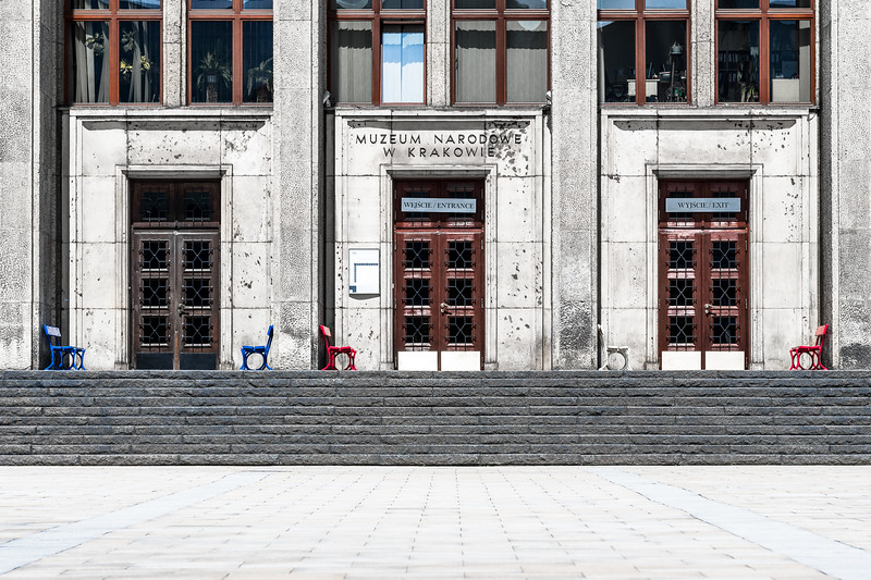 Five coloured chairs adorn the stark facade of Krakow's National Museum.