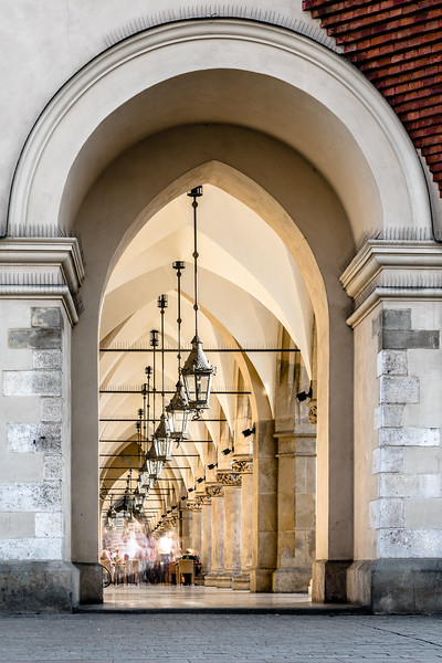 Evening light spills into the covered passageways of Krakow's cloth hall.