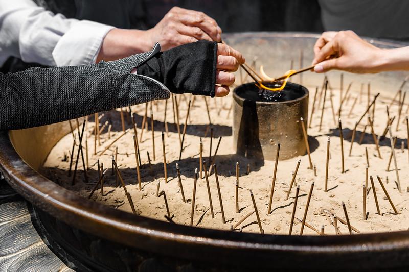 Pilgrims offer incense at Nara's Tōdai-ji temple.