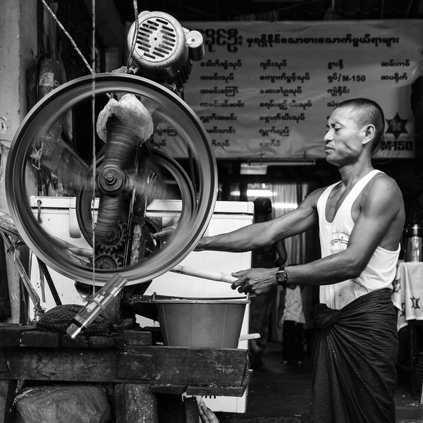 A Naypyidaw cane juicer at work, surrounded by several eras of machinery.