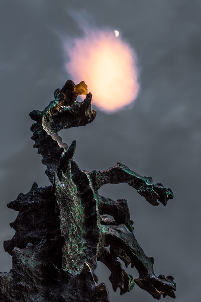 Bronisław Chromy's 1970 statue of the Wawel dragon spits fire at the rising moon.