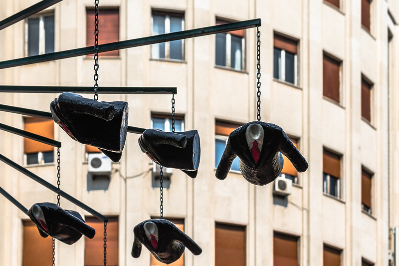 Headless suits hang from a mobile on Belgrade's Park Vojvode Vuka.