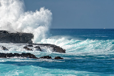 Surf hitting Kaiwi Point near entrance to Honokohau harbor. Big island of Hawaii.