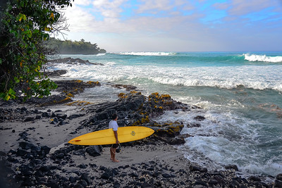 WNW swell of January 22, 2015. Unidentified with beautiful Brewer gun ready to paddle out at Banyans. Kailua-Kona, Hawaii.
