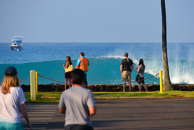 WNW swell of January 22, 2015. Cop telling clueless tourists to step away from the seawall. Kailua-Kona, Hawaii.