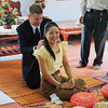 Here I am placing gold necklace on Id.  Gold is a big part of Thai ceremonies.