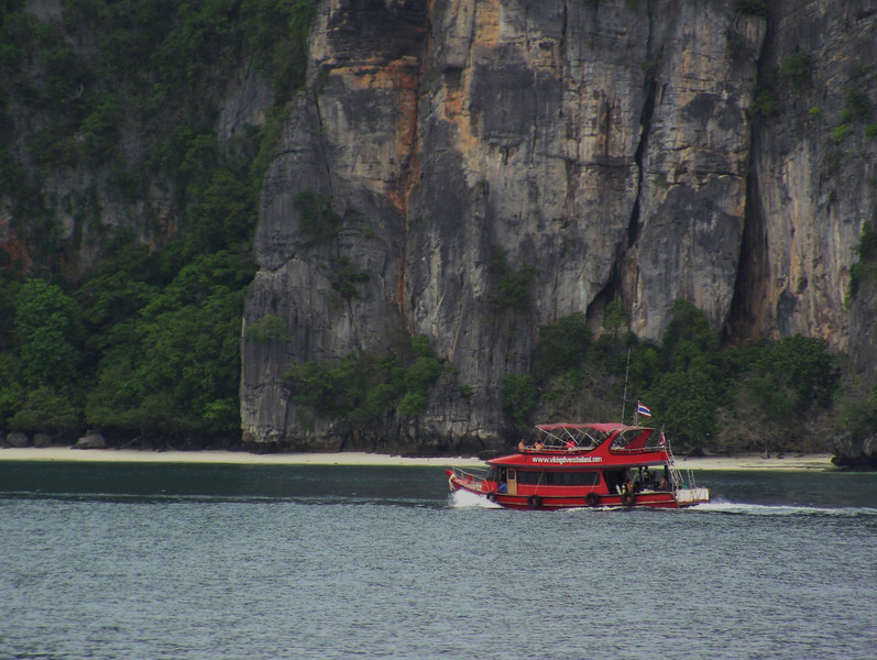 A boat leaves Phi Phi Harbor
