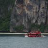A boat leaves Phi Phi Harbor