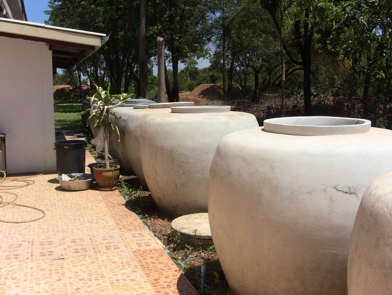 Rain water tanks behind the school.
