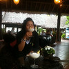 """We did a rough """"PersTrans"""" (personal transfer at sea) from the ferry to a small boat to get ashore at the Phi Phi Villiage Resort.  A delicious frozen coconut drink awaited us.  Ahhh!!"""