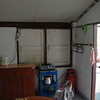 The kitchen at Id's house. Simple, propane tank for fuel.