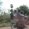 family of 4 on little motorcycle, a common site in Thailand