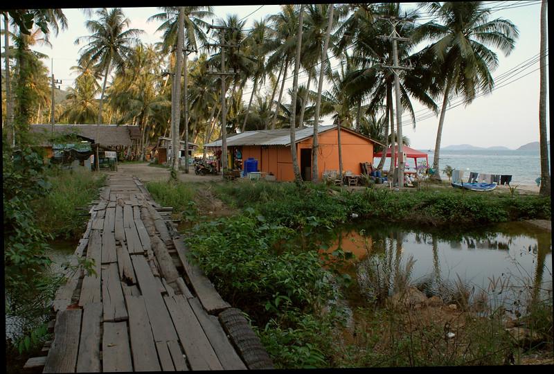 across the street from the monkeys, a clapboard bridge leads to a secret beach.
