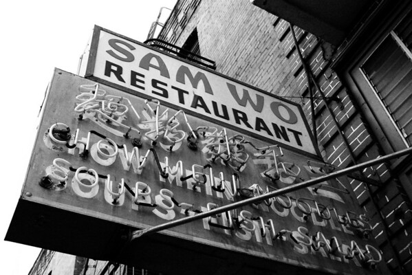 Sam Wo Restaurant - Black & White  Stairway to heaven more like stairway to hell. grit grime wet dingy streets of Chinatown service. did she just say hello? no just a grunt and a look of tired delusion after sixty plus years of climbing those stairs standing over a steaming pot serving degenerates drunken misfits.   damn north beach and their crazy western ways.  won ton soup and chicken chow mein. no chop suey. quick service.  spicy makes tasteless tasteful. thanks for the bottled water. check please   cheap meal plus msg did I hear a faint 'um goy' through the kitchen? nah just another sneeze in the frying pan.