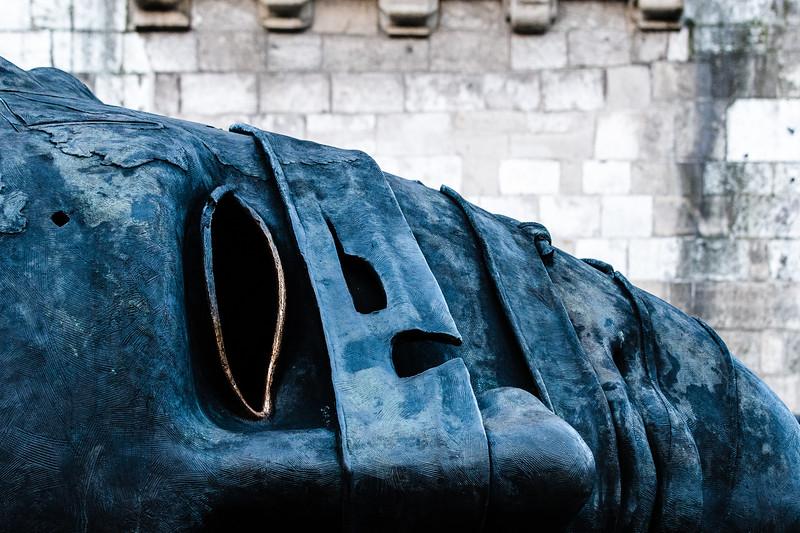 "Igor Mitoraj's ""Eros Bendato"" lies at the foot of a tower on Krakow's market square."