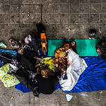 A refugee family, stranded in the underpasses of Budapest's Keleti station, share dinner one night in September 2015.