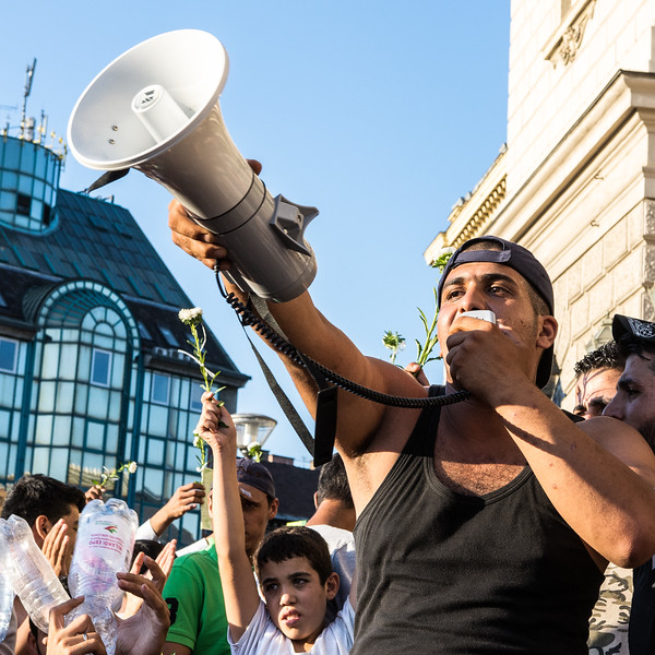 A spokesman for the hundreds of refugees stranded at Budapest's Keleti station leads the crowd in a protest against their detainment by Hungarian authorities.