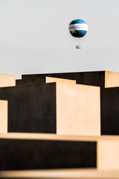 An advertising balloon looms over the alien landscape of Berlin's Memorial to the Murdered Jews of Europe.