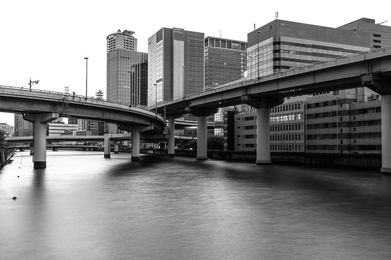 Interweaving overpasses traverse one of Osaka's canals near Yodoyabashi.