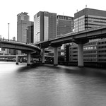 Interweaving overpasses traverse one of Osaka's canals near Yodoyabashi.