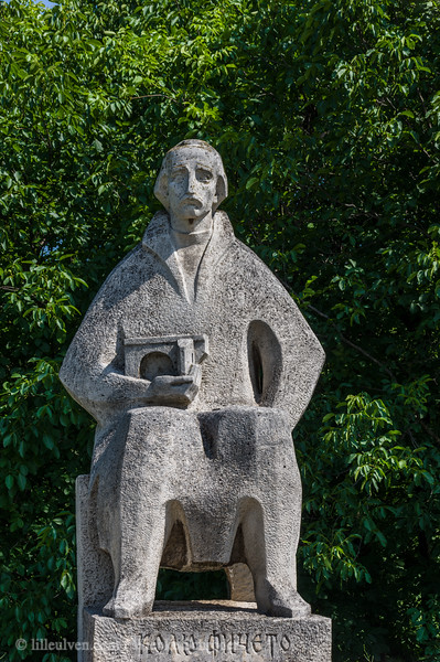 Statue of Kolju Fitcheto (Колю Фичето) holding a model of the Belenski Most – From Bridges to rock-hewn monasteries and more waterfalls