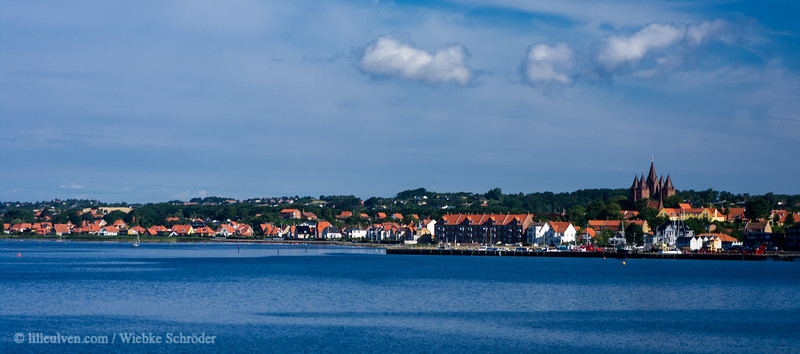 Kalundborg as seen from the ferry crossing the Great Belt toward Samsø (Samsoe) with the Church of our Lady (Vor Frue Kirke) and its five towers in the background.