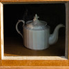 Tea pot in the window frame