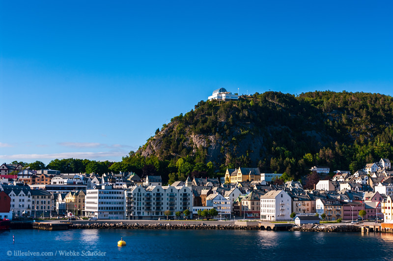 Looking upon the city of Ålesund which is known for its Art Nuveau buildings. This photo is also published in Lille Ulven Photography's English Norway calendar.