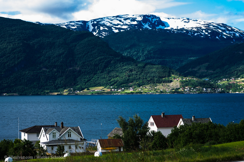 The village of Leikanger and the Fresvikbreen in the background - located on shore of the Sognefjorden, the longest of all Norwegian fjords.
