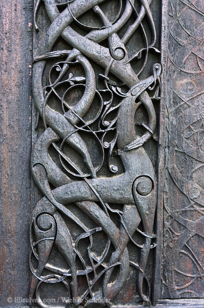 Urnes Stave Church (Stavkirke) - build between 1150 and 1200, the northern portal and other parts are from an older building. It has been on the Unesco's world heritage list since 1980. Wooden carvings on the northern portal show how people in the old days imagines lions to look like.