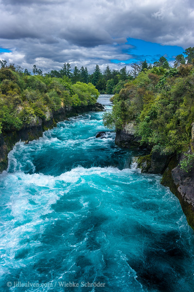 At the Huka Falls, the Waikato River which is normally 100m wide, is squeezed through a 20 metre wide gorge and over a 20m drop.Every second up to 220,000 litres of water gushes through the gorge and shoots out over 8 metres beyond to create a beautiful blue/green pool.The name Huka is the Maori word for 'foam', which is appropriate as the falling water and rapids certainly resembles foam, especially under flooding conditions. Source: www.hukafalls.com