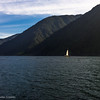 """<span class=""""wsc_subtitle"""">Fiordland National Park, Milford Sound, Southland, New Zealand</span>  Milford Sound  Milford Sound/Piopiotahi is 120 km by road from Te Anau. Its surroundings are dominated by Mitre Peak, which rises 1,700 m out of the water. From valleys gouged by glaciers, impressive waterfalls (Bowen and Stirling) pour into the sea.  The sound's Māori name, Piopiotahi, means a single thrush: the mythical hero Māui is said to have brought a thrush with him from Hawaiki. When Māui was crushed between the thighs of Hine-nui-te-pō (the goddess of death), the bird fled south, to give its name to the sound.  The combination of heavy rainfall (6,300 mm per year) and dense bush produces a permanent layer of fresh water on the surface of the sound, which reduces light levels in the water beneath. Many species live here that would normally only be found in deep water, beyond diving range – a phenomenon called 'deep water emergence'. As in other fiords, divers can explore black coral trees, and lustrous red corals beneath them.  Source: David Grant. 'Southland places - Milford Sound and north', Te Ara - the Encyclopedia of New Zealand, updated 13-May-15 URL: <a href=""""http://www.TeAra.govt.nz/en/southland-places/page-12"""" class=""""wsc_text"""">http://www.TeAra.govt.nz/en/southland-places/page-12</a>   <span class=""""wsc_subtitle_small""""> uuid=""""2069A80C-0187-4826-992A-5EE2DEDE4077"""" id=""""New Zealand lilleulven.com 20130127_092959_NZ_Southland_Milford Sound__www.LilleUlven.com.DNG New Zealand South Lilleulven.com""""</span>"""