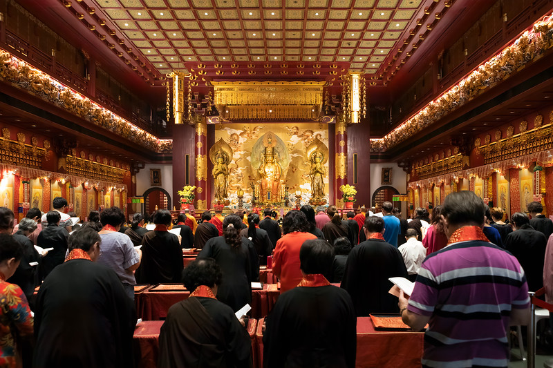 Worshippers Praying Inside a Buddhist Temple in Singapore's China Town