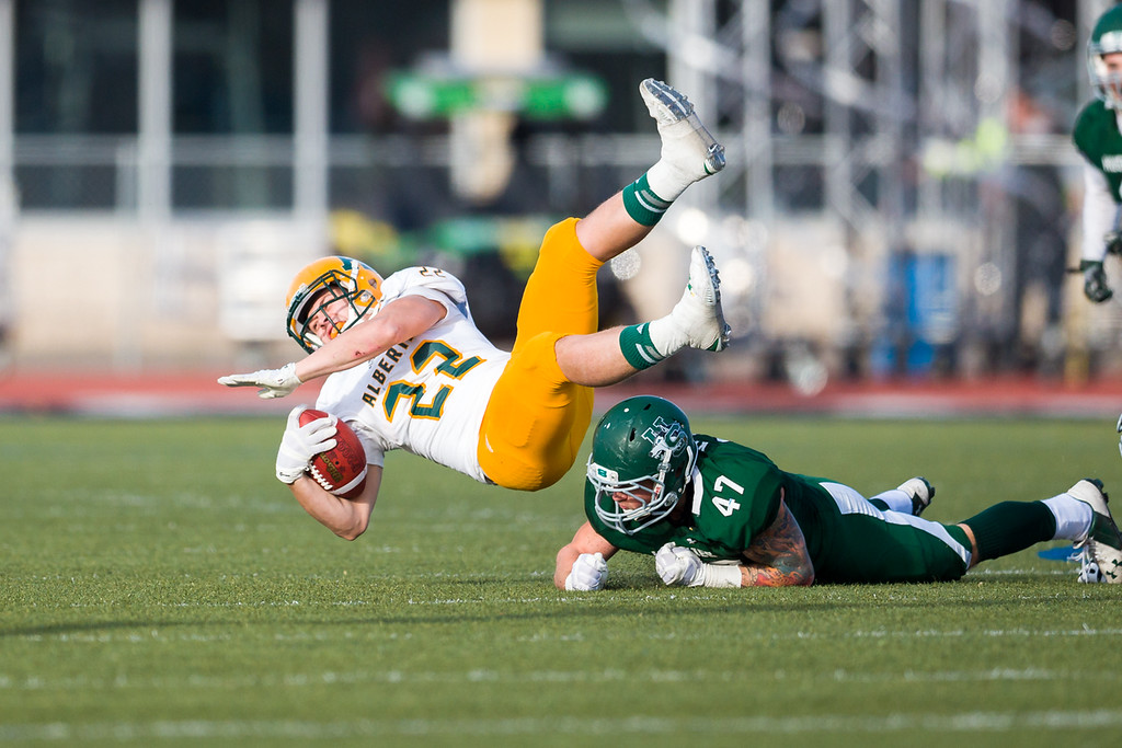 IMAGE: http://www.justsportsphotography.ca/Photos/U-of-S-Huskies/2014/Football/Huskies-v-Golden-Bears/i-4bKJtm8/0/XL/Golden%20Bears%20v%20Huskies%200699-XL.jpg