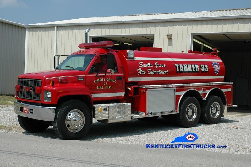 <center> Smiths Grove  Tanker 33 <br> 1998 GMC 8500/Midwest Fire 0/3000 <br> Greg Stapleton photo </center>