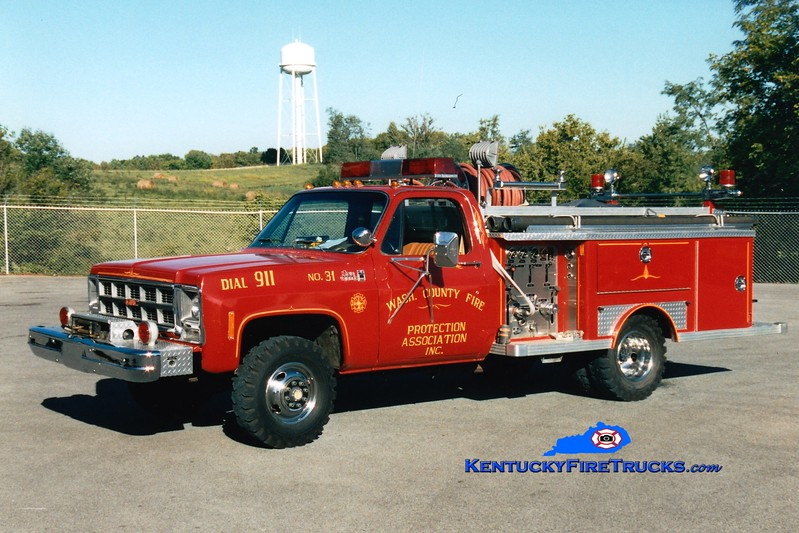 <center> RETIRED <br> Washington County  Engine 31  <br> 1982 Chevy 4x4/E-One 250/250 <br> Greg Stapleton photo </center>