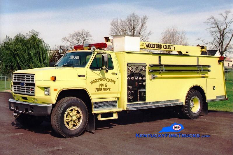<center> RETIRED <br> Woodford County  Engine 6 <br> 1986 Ford F-800/Allegheny 250/1000/35' <br> Greg Stapleton photo </center>