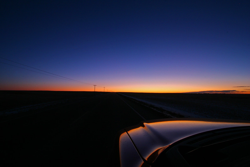 Magic Time - This photo I shot on the Siksika First Nations land as I headed east just as the dawn breaks on the eastern horizon. I am using the open door with a bean-bag for a camera rest.