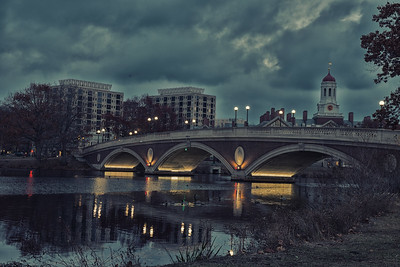 Harvard Bridge over the lazy Charles River at dusk.