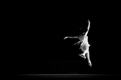 A figure skater leaps through the air