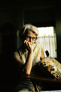 I like this picture of Mom.  The back cushion of the chair seems to have fallen forward.  I'd love to know what she is looking at, or thinking about.