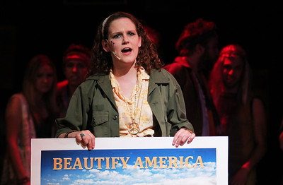 Maggie Poole, a sophomore Dramatic Arts and Music Minor, performs in Pauper Players' production of Hair.