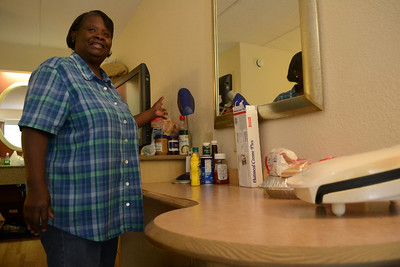 After being evicted from Collins Crossing, Sula Eubanks moved to Red Roof Inn with her husband, daughter. and two chihauhaus. They have learned to make do with fewer immenties by cooking on a George Forman Grill and keeping perishable food iced in the sink.