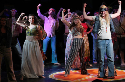 The cast of Pauper Players' production of Hair performs a number.