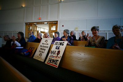"""The Raging Grannies of Chapel Hill held a peace talk event called """"Bring Our War Dollars Home"""" at the United Church of Christ of Chapel Hill on Saturday morning. More than a dozen community leaders spoke to the crowd, including Chapel Hill Mayor Mark Kleinschmidt, Representative David Price, N.C. Senator Ellie Kinnaird and UNC student Zaina Alsous.  The Raging Grannies clapped during and after every speaker and wore peace paraphernalia."""