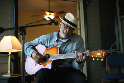 Logie Meachumplays his guitar and sings at Music on the Porch to celebrate the Center for the Study of the American South's 20th birthday.